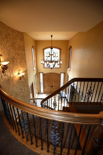 Entryway of a new home with a custom rail and staircase